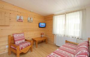 Télévision ou salle de divertissement dans l'établissement Hotel le Sherpa