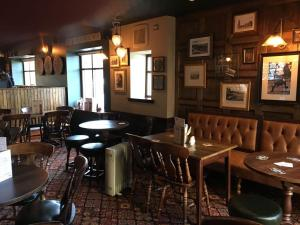 A restaurant or other place to eat at Greyfriars Inn by Greene King Inns