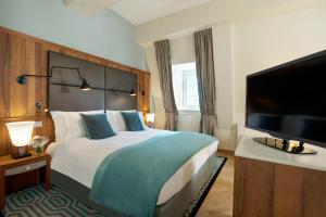 Łóżko lub łóżka w pokoju w obiekcie Sofitel Grand Sopot