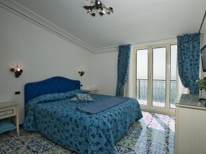 A bed or beds in a room at Gorgeous Holiday Home in Praia with a Breathtaking Seaview
