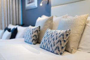 A bed or beds in a room at The Barnstaple Hotel