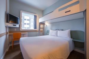 A bed or beds in a room at Ibis budget São Bernardo Do Campo