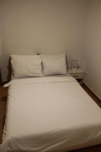 A bed or beds in a room at Villa Omazic