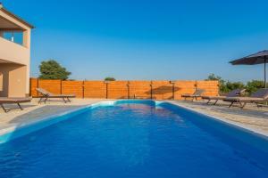 The swimming pool at or close to Villa Roko