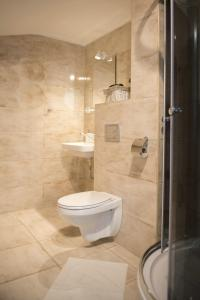 Kúpeľňa v ubytovaní Olla apartmány