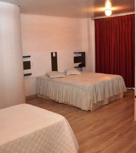 Cama ou camas em um quarto em SCHÄFER HOTEL