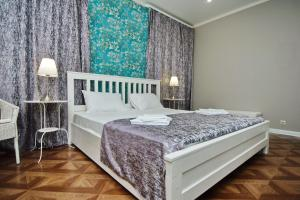 A bed or beds in a room at Park Hotel Polyana