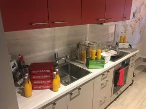 A kitchen or kitchenette at Le Jour et la Nuit