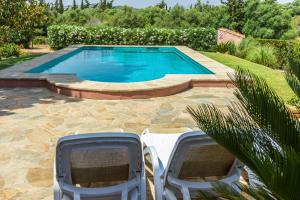 The swimming pool at or near Villa Alzina