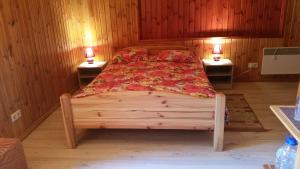 A bed or beds in a room at Pie Pētera