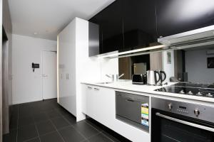 A kitchen or kitchenette at Immaculate 2BR with 2 Bathroom Private Unit in CBD