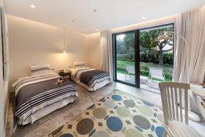 A bed or beds in a room at D-Resort Gocek Special Category