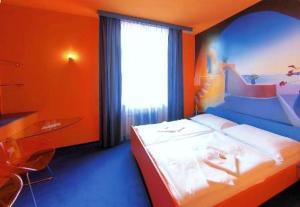 Postel nebo postele na pokoji v ubytování Hotel Liberec