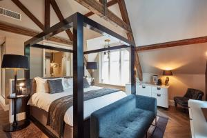A bed or beds in a room at Oddfellows On The Park