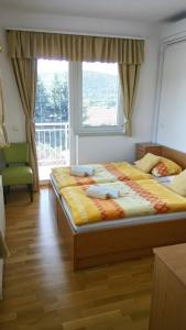 Кровать или кровати в номере Gostišče Lunca