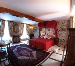 Un ou plusieurs lits dans un hébergement de l'établissement Hôtel L'Ecrin