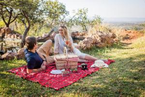 A family staying at Leopard Mountain Safari Lodge