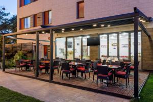 Un restaurant sau alt loc unde se poate mânca la Tomis Garden Aparthotel