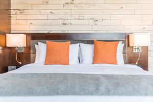 A bed or beds in a room at The Fin Hotel, Tapestry Collection by Hilton