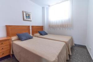 A bed or beds in a room at Ibersol Sol De España