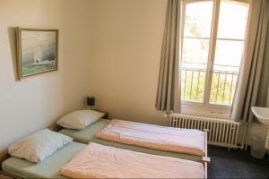 Ein Bett oder Betten in einem Zimmer der Unterkunft Zofingen Youth Hostel