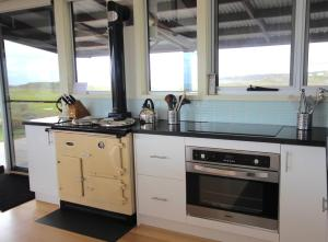 A kitchen or kitchenette at Turnstone Beach House