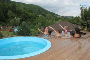 The swimming pool at or near Mir Solntsa