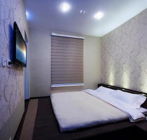 A bed or beds in a room at Aqua De Vida