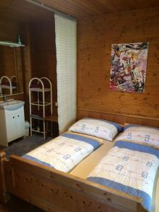 Ein Bett oder Betten in einem Zimmer der Unterkunft Waldhaus Lechner