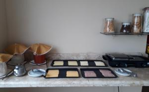 A kitchen or kitchenette at Serra Plaza Hotel