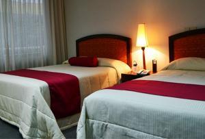 Postel nebo postele na pokoji v ubytování Hotel Mediterraneo Sa De Cv
