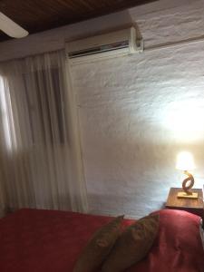 Cama o camas de una habitación en Hotel Del Pasaje