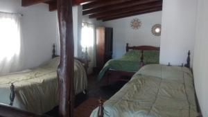 A bed or beds in a room at Casa El Mortero