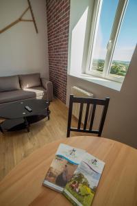 A seating area at Appart Hotel de la Souleuvre