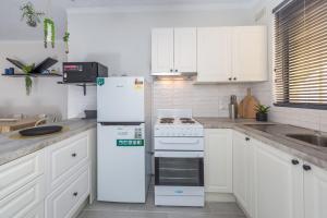 A kitchen or kitchenette at Bay Village 2 - Shoal Bay