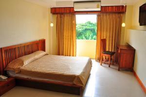 Postel nebo postele na pokoji v ubytování Sathorn Saint View Serviced Apartment