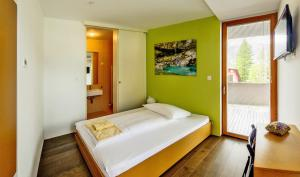 A bed or beds in a room at Hotel Sanje ob Soči ***/****