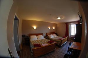 Un ou plusieurs lits dans un hébergement de l'établissement La Vieille Auberge