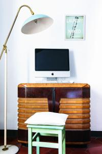 TV o dispositivi per l'intrattenimento presso Little Garden House