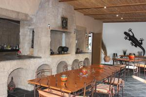 A restaurant or other place to eat at Cheetah Lodge Guest House