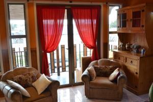 A seating area at Cabaña Galvarino Puerto Natales