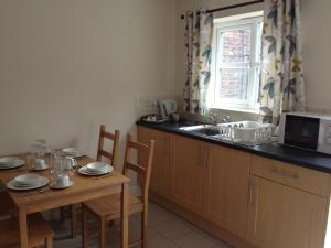 A kitchen or kitchenette at The Waverley Hotel