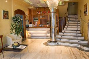 The lobby or reception area at Hotel Arillo