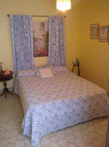A bed or beds in a room at Can Bernnassar