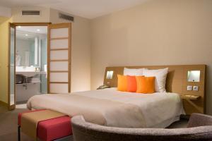 Un ou plusieurs lits dans un hébergement de l'établissement Novotel Lille Centre Gares