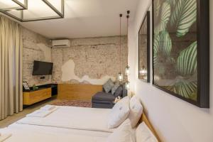 A bed or beds in a room at R34 Boutique Hotel