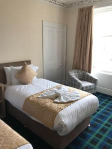 A bed or beds in a room at Royal Guest House Nairn