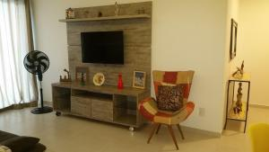 A television and/or entertainment centre at Arraial do Cabo - Le Bon Vivant 201