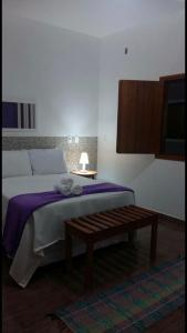 Cama o camas de una habitación en Loft Vila do Sossego