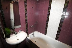 A bathroom at Business Apartment Vologda Center